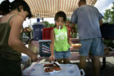 Top priority on a camping trip is cook the dogs.  Dad, Phillip Quintana of Commerce City (r) put...