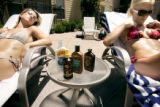 Lauren Lyons (cq, right), 24, of Denver and friend Sonia Brusch (cq, left), 26, of Aurora relax in...
