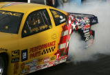 Warren Johnson smokes his tires before running in the Pro stock final heat on the final day of the...