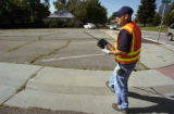 James Salazar , a water leak detection worker for  the Denver Water  department checks for a water...