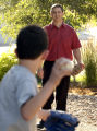 Jeff Black (cq)  plays catch with his son,  Ryan (cq), 10, at their home in Longmont  Tuesday,...