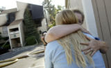 (Lakewood, Colo., July 5, 2005) Michelle Dechant, left, gets a hug from her mother, Karen...