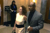 A victim of Brent J. Brents leaves Denver County court with her fiancee after Brents pleaded...