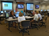Workers at the State Emergency Operations Center on Mineral Ave in Littleton Colorado do their job...