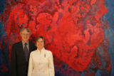 Hugh Grant and Merle Chambers, standing in front of a Vance Kirkland painting in Aspen, Colorado,...