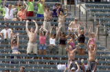 Fans sparsley fill the outfield bleachers as the Colorado Rockies beat the Los Angles Dodgers 8-5,...