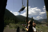 Kristina Riggs, cq, 19,(left) assistant ropes director and Christian Baca, cq, 17, (right) camp...