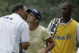 On the 18th hole, Angela Stanford, (c) gives Mi Hyun caddie John Wilkes (l) a kiss on the cheek...
