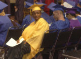 Afton Harris looks back at his brother during  high school  graduation ceremonies held Friday July...