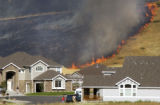 Fire spreads north of Golden, Colo., on North Table Moutain as it treathens homes Friday July 22,...