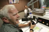 Conservitive talkshow host Jim Fisher, left, laughs with Rep. Tom Tancredo, R-Littleton in the WOC...