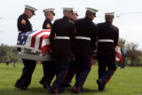 Marine Honor Guard members carry the casket of Lance Corporal Chad Maynard, 19, during funeral...