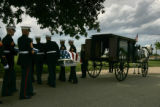 Marines carry the casket of Lance Corporal Chad Maynard, 19, from a funeral carriage that was...