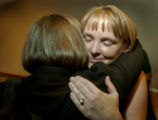 Jennifer Bier (cq), right, gets a hug from Media Coordinator for the Colorado Coalition Against...