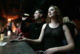 Kyle Scoby (cq), left, 28, of Denver, and Rachel Abrahams (cq), right, 26, of Denver, drink and...