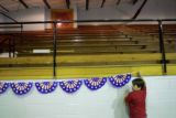 Luis Ramirez, 8, holds a banner while helping to decorate Manzanola High School on Friday, June...