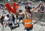 Colorado Crush fan Pete Martinez (cq) wears a barrel as he walks into the Thomas & Mack Center...