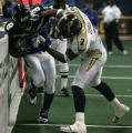 Delvin Hughley, of the Colorado Crush, right, tackles Derek Lee, of the Georgia Force, in the...