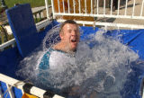 (Denver,CO,Shot On 4/26/04-- Avalanche intern Wes DeLancey, 22, as he gets dunked by a fan who...
