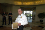 Aurora Fire Chief Casey Jones (cq) answers question from the media Sunday afternoon June 12, 2005....