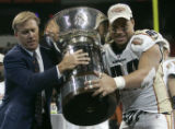 Colorado Crush co-owner John Elway and Saul Patu hand the cup down to their fellow players after...