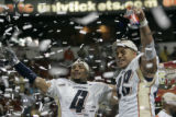 Rashad Floyd, left, and Saul Patu, right, celebrate winning the Arenabowl XIX Championship Game at...