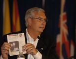 Stephen Johnson, U.S. EPA Administrator  shows a picture of Governor Bill Ownes in a news paper...