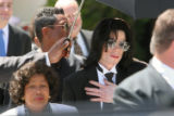 (NYT36) SANTA MARIA, Calif. -- June 13, 2005 -- JACKSON-TRIAL-6 -- Michael Jackson is accompanied...