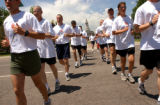 [Denver, CO - Shot on: 6/3/04]  Dozens of Colorado law enforcement officers run with the Colorado...