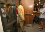 [Centennial, CO - Shot on: 6/3/04]  Shannon Sharpe leaves a press conference where he said his...