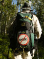 Chuch Simmons  (cq) wears a sign on his backpack Sunday morning June 25, 2005 in Silverthorne...