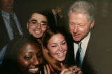 Copy photo of Keith Montoya, upper left, CEO of Doc.1 Solutions with Bill Clinton, right, that he...