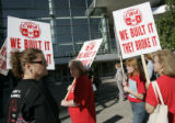 Members of the CWA union picket the front of the Colorado Convention Center as AT&T...