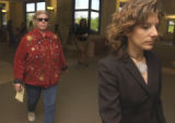 Catherine Cariaso (left) exits Larimer County Court on Thursday June 16,2005 where she is charged...