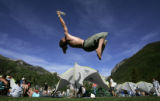 Anthony DiGiacco (cq), 23, of Farmington, NM., does a back flip while catching a frisbee at the...