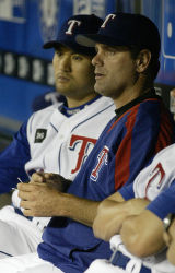 NY169 - Texas Rangers pitcher Kenny Rogers, right, sits in the dugout during a game against the...