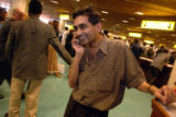 (NYT45) NAIROBI, Kenya -- June 29, 2005 -- NAIROBI-AIRPORT -- Sanjai L. Shah reacts on Wednesday,...