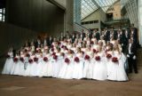 (Denver, Colo., June 11, 2005) Young men of distinction and debutantes pose for the formal photo. ...