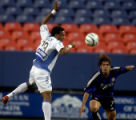 Kansas CIty Wizards player Scott Sealy, left, and Colorado Rapids player Luchi Gonzalez, right,...