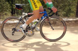 (BOULDER, Colo., May 5, 2005) Tyler Hamilton ticks over his pedals as he rides along a dirt road...