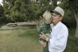 Richard Holm with his son, Logan, 4, during a visitation with 7 of his 14 children at his ranch...