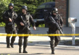 Police and SWAT teams from Thornton and Federal Heights during a standoff on Monday June 20,2005...
