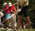 LPGA pro Cristie Kerr, center, hits balls along with Michelle Redman, right, and Bernadette Luse,...