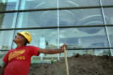 Construction worker Antonio Hernandez takes a break from digging outside the Colorado Convention...
