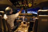 Denver, CO July 5, 2005 Dave Little, a flight simulator technician, prepares a simulator for a...