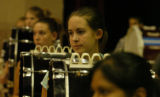 Sarah Cross(cq), in focus, a ninth grader from Northglenn High School, waits for her conductor to...