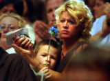 (COLORADO SPRINGS, CO. JUNE 4, 2004) (center) Susan Saunders, of Colorado Springs, holds her son...