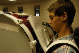Andrew Wilson(cq), a junior from Thorton High School, reads over his sheet music before practicing...