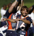 Denver Broncos' quarterback, 16, Jake Plummer, cq, stretches during the moring practice during the...