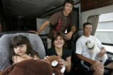 Nationwide Tour golfer Shane Bertsch, 35, far right,  cq, of Parker, holds the family dog, Moby,...